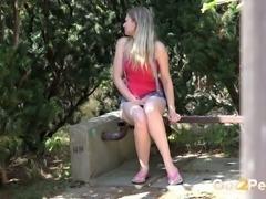 Sweet blonde summer girl in denim shorts  pisses in the garden