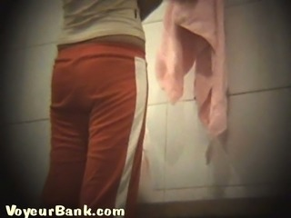Slender white chick undresses in the locker room on hidden cam