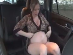 My nasty pregnant wife masturbates with a dildo in the car