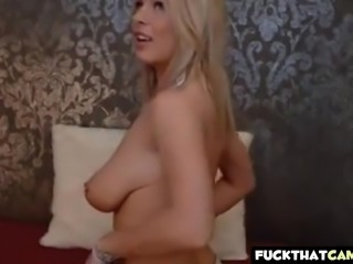 Hot blondie with big suckable tits plays with her toy