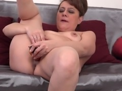 sexy mature gilda shoves a dildo in her wet pussy