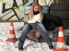 Blonde hot white girl pulls down her jeans and pisses on the tires