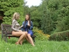 Lesbian fingering action outdoor