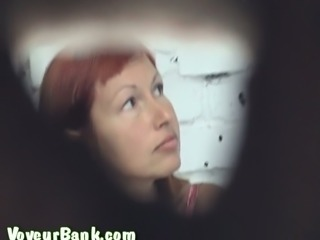 Redhead hot white milf in the public restroom got her pussy filmed