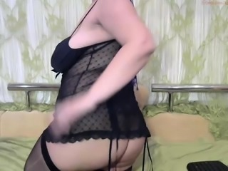 Milf in black lingerie fingering slippery pussy