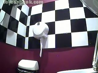 Chunky brunette white milf in black dress in the restroom