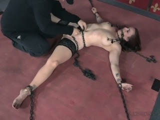 Sweet auburn haired white girl chained and gagged with wooden stick