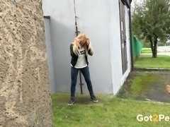 Blonde white young chick releases urine that she was holding on for too long