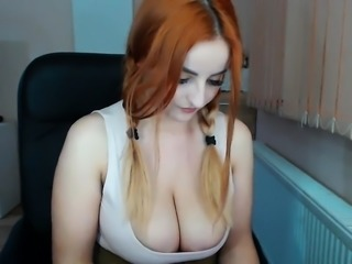 Redhead with big boobs riding cock on the chair