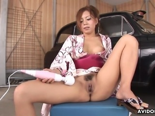 Traditionally dressed Japanese redhead toys her pussy in the garage