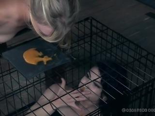 caged slave gets her meal