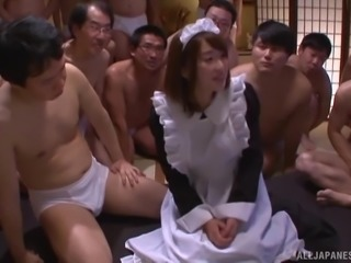 Bunch of horny men attack a sweet Japanese maid for a gangbang
