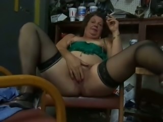 Perverted extremely fat webcam brunette mature whore smokes and flashes slit
