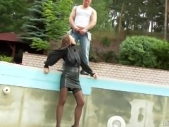 Wet clothed chick is fucked hard by one kinky dude outdoor