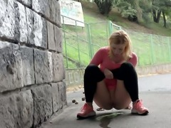 Cute blonde teen babe pulls down her black tights and pisses