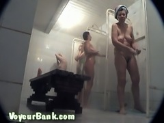 White amateur women in the public shower room washing on hidden cam