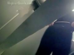 Voyeur in the next toilet room films white booty of a stranger girl
