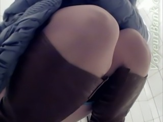 Chunky white lady in nylon pantyhose and dress pisses in the toilet