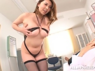 Seductive Asian cougar having her big tits sucked before giving amazing titjob in reality shoot