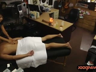 Asian babe gives massage to pawn man before getting boned