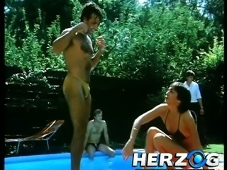 Short haired lean busty babe by the pool sucking dick