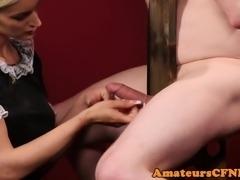 Cocksucking babe dominates naked sub