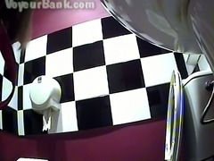 Long haired brunette girl in the toilet pissing on hidden cam