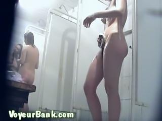 Lovely and slim white brunette girl in the shower filmed nude