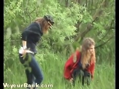 Two white amateur ladies in the forest pissing together