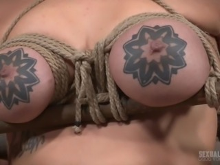 Scarlet is at the mercy of Sergeant Miles, who has pretty much nothing to offer in that department. You need only see how he treats her tits with those ropes and wooden poles to know that! It doesn't matter about her discomfort as you can see, but how she sucks a dick.