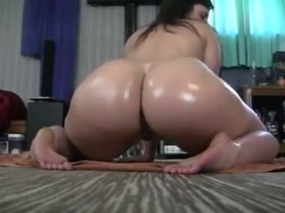 Darn fantastic brunette with oiled booty goes solo right on the floor