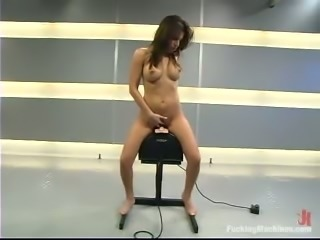 Sexy brunette Sativa Rose tests a fucking machine and gets orgasm