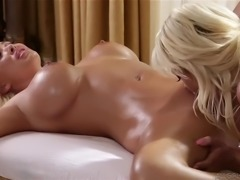 busty blonde milfs eat one another's pussies after a massage therapy
