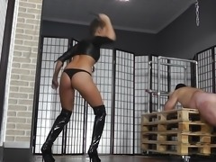 Hot young brunette mistress whipping her slave