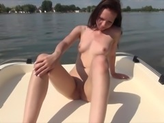 Pale chick gets naked for a hot solo session on a boat