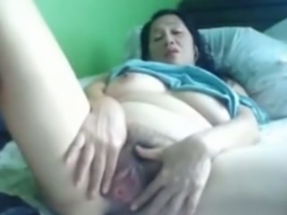 Filipina black haired slut with enormous big tits and ass masturbates herself