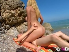 Eli Tetona is a hot blonde who likes being plowed on a beach