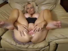 Wonderful super flexible blond haired MILF with big tits masturbates her wet...