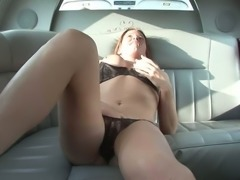 Red haired slutty girlfriend in sexy lingerie masturbates on the back seat of...
