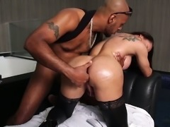 Awesome blowjob is given to a lucky black stud by ladyboy Amanda Ferreira