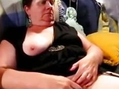 Chubby mature rubs on her sofa