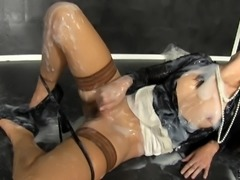 Lovely clothed woman gets covered in slime at a gloryhole