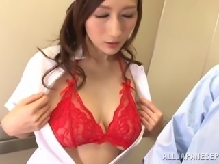 Beautiful Japanese nurse in glittering red bra having her big tits caressed passionately in POV