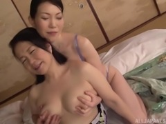 Mature Asian woman seduced by an insatiable lesbian