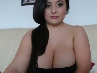 Amazing long haired chunky black head exposes her really huge melons