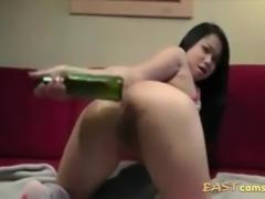 Chubby ass Asian slut fucks her hole with a bottle