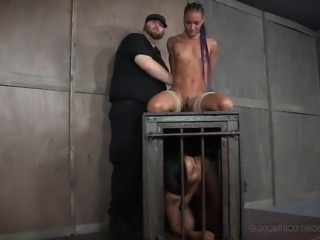 Slender black chick Nikki Darling gets tied up and her nipples pinned