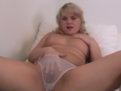 Blond haired mature nympho with big rack and big titties rubs her clit