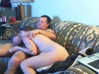 Mature aunt giving head to her husband in living room