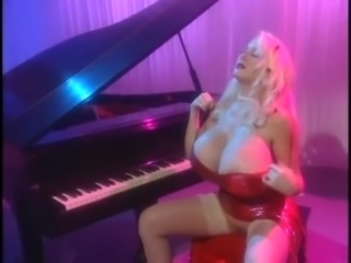 Kayla Kleevage is a hot retro milf blonde with very big tits